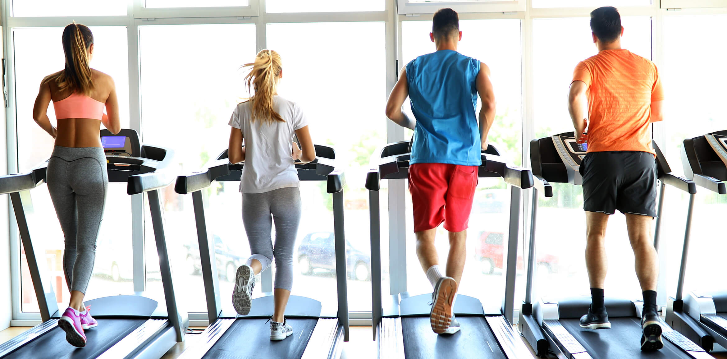 People working out on treadmill